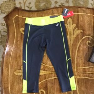 Grey workout pants trimmed in bright yellow